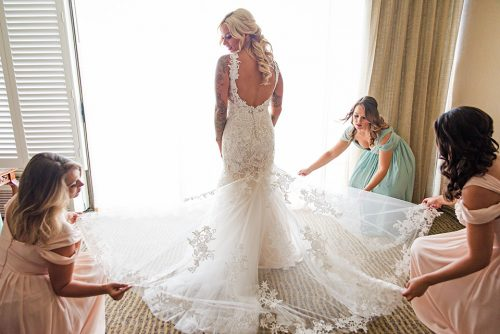 bridal-gown-getting-reading-Catamaran-San-Diego-wedding-photographer