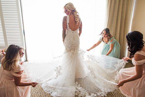 bridal-gown-getting-reading-Catamaran-San-Diego-wedding-photographer