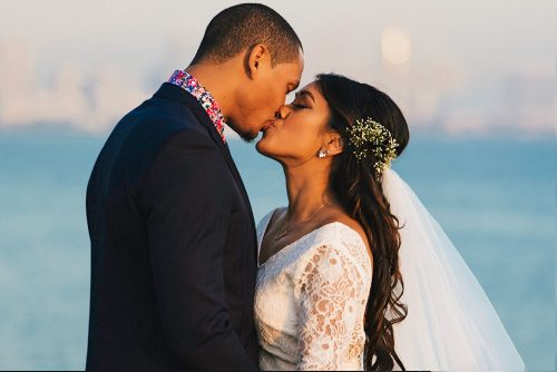 bride groom kissing san diego skyline