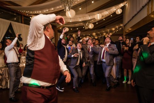 groom throwing the garter jalea photography