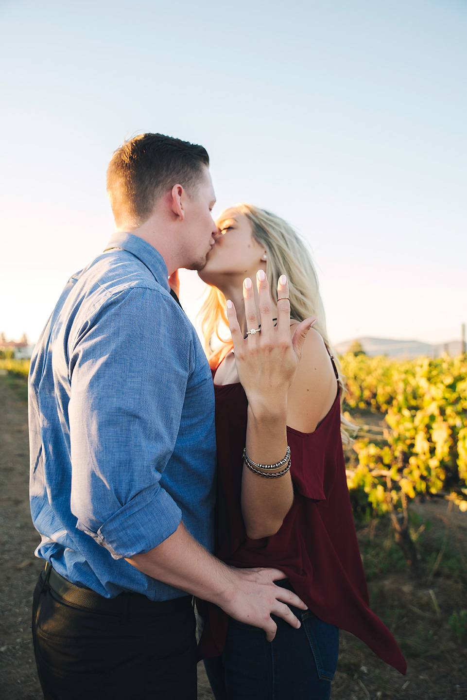 engaged couple kissingsouth coast winery temecula
