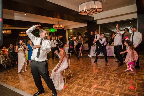 groom-throwing-garter-tom-ham's-lighthouse-san-diego-wedding-photographer