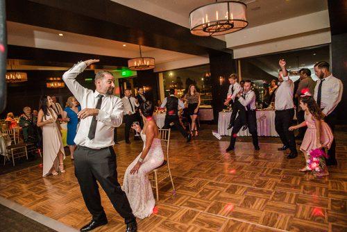 groom-throwing-garter-tom-ham's-lighthouse-san-diego-wedding-photographer