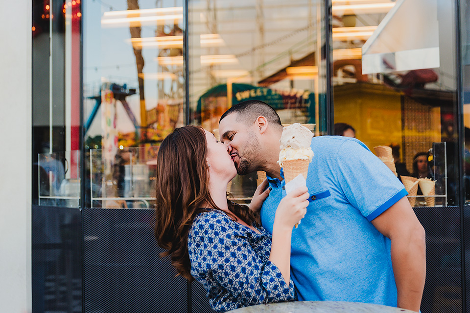 engaged couple kissing Belmont Park San Diego