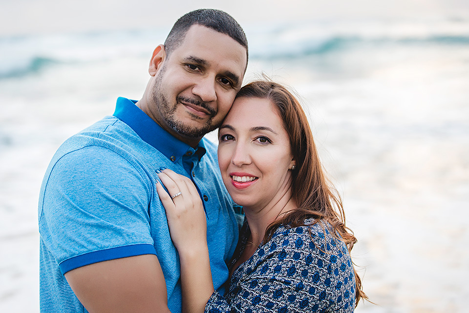 engaged couple hugging at Mission Beach San Diego