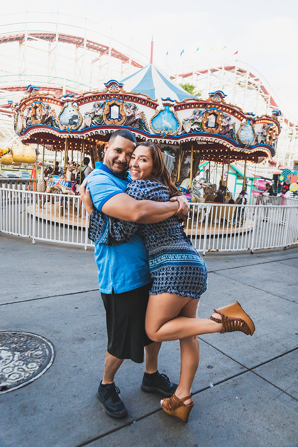 engaged couple in front of carousel Belmont Park San Diego Photo Shoot