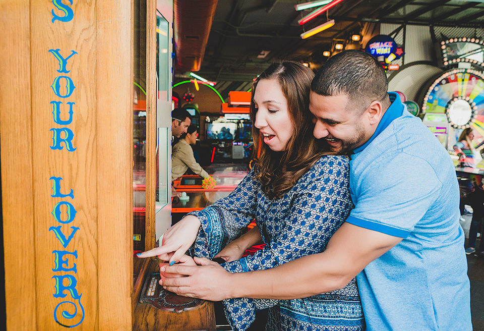 engaged couple playing games Belmont Park San Diego