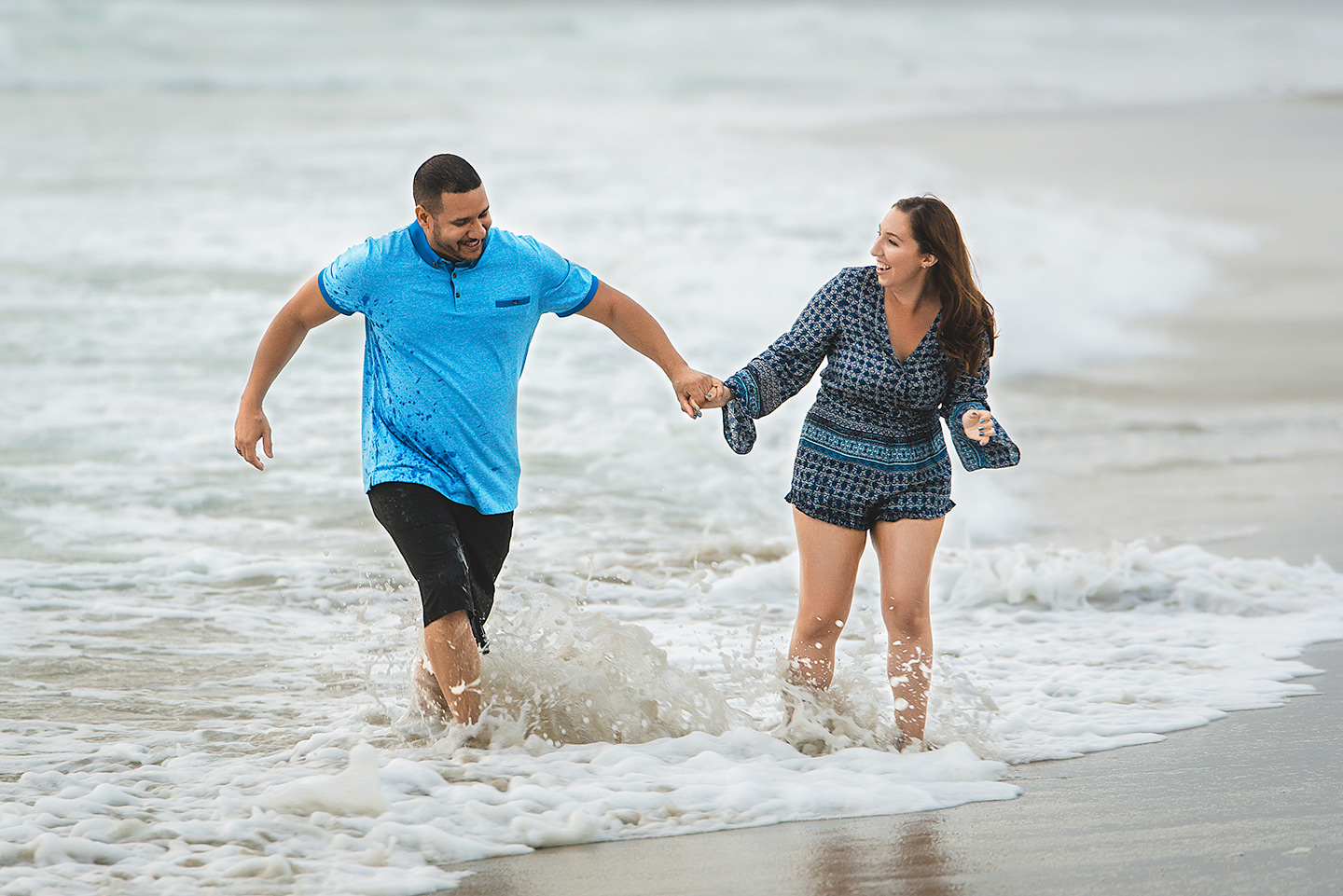 couple-playing-in-water-san-diego-mission-beach