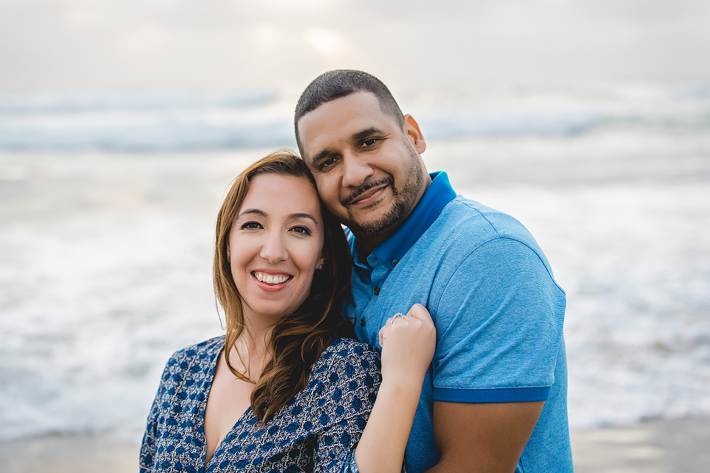 engaged-couple-posing-mission-beach-san-diego