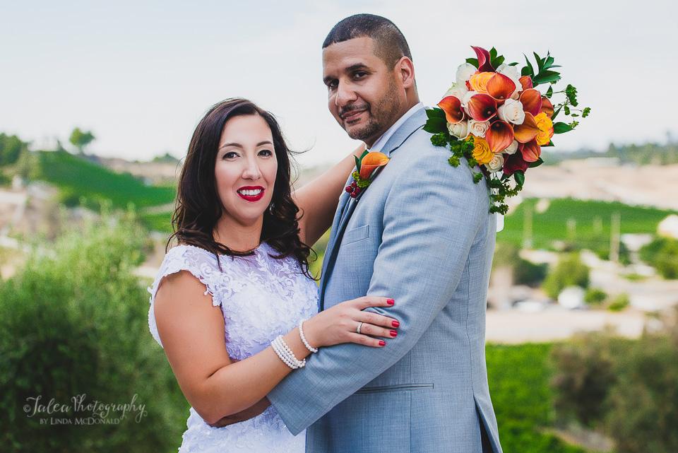 bride and groom posing at oak mountain winery wedding temecula ca