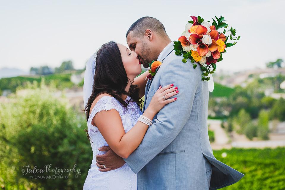 bride and groom kissing Oak Mountain Winery wedding Temecula ca