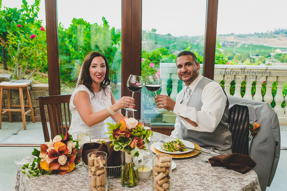 bride and grooming toasting wedding reception oak mountain winery temecula ca