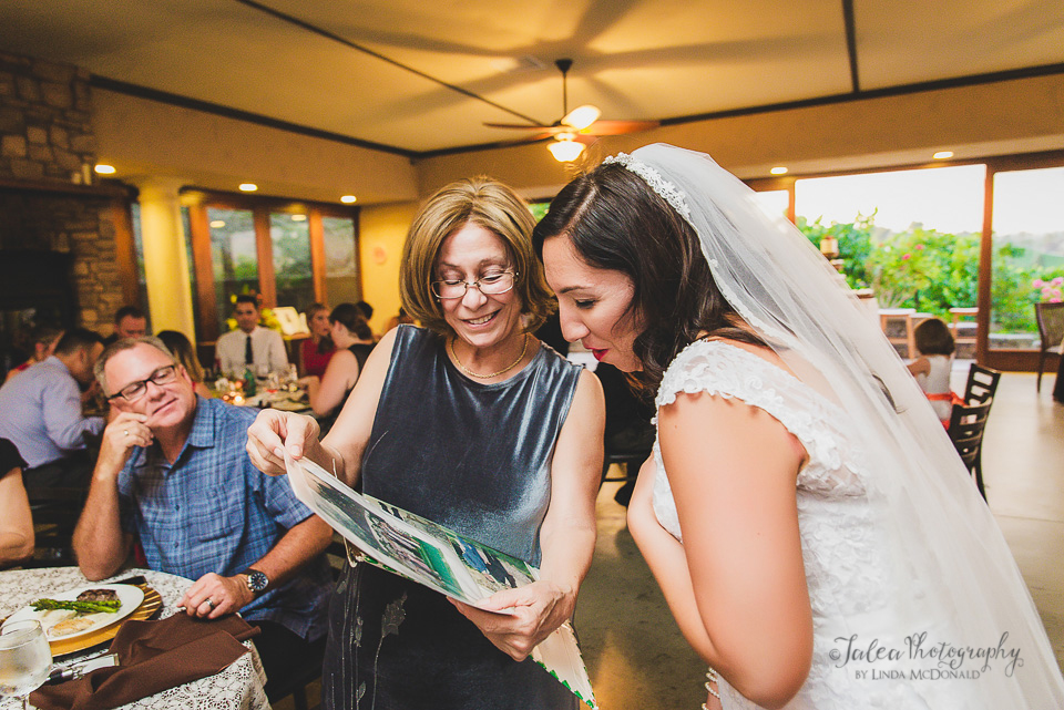 bride interacting with wedding guest oak mountain winery temecula ca