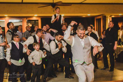 groom tosses garter wedding reception oak mountain winery temecula ca