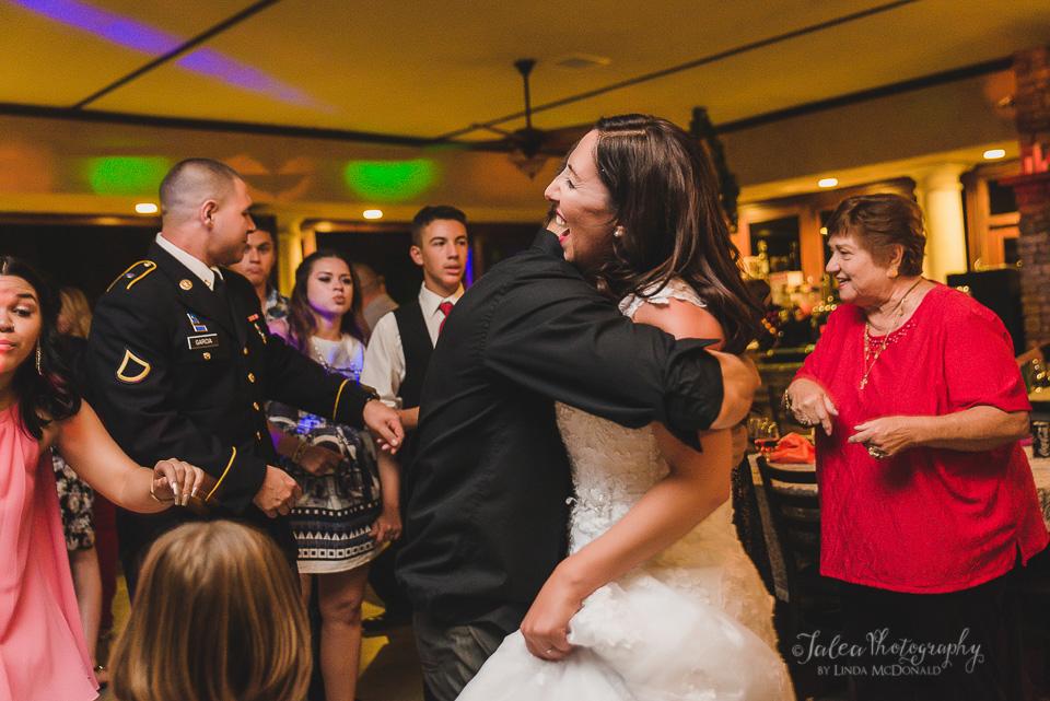 bride getting hugged wedding reception oak mountain winery temecula ca