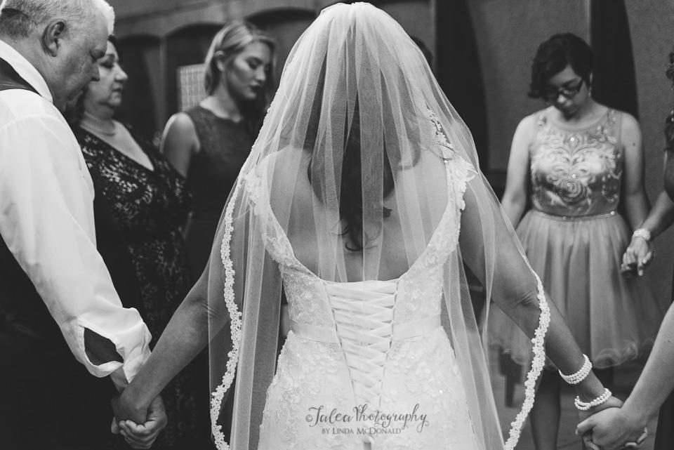 prayer circle before wedding ceremony at oak mountain winery wedding temecula ca