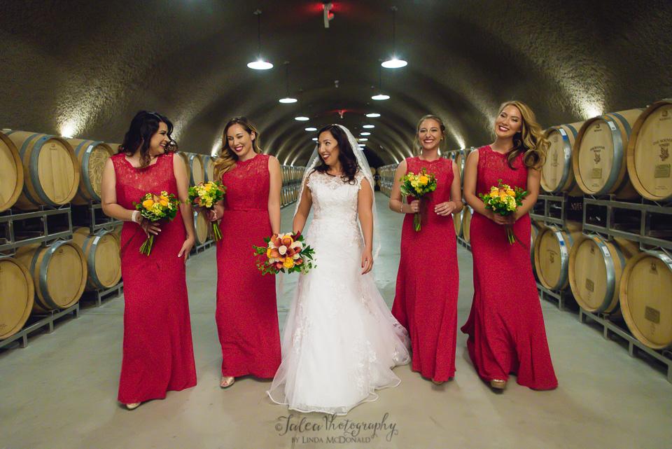 bride and bridesmaids walkingin cave at oak mountain winery temecula