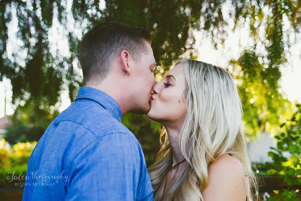 engaged couple kissing at South Coast Winery hotel