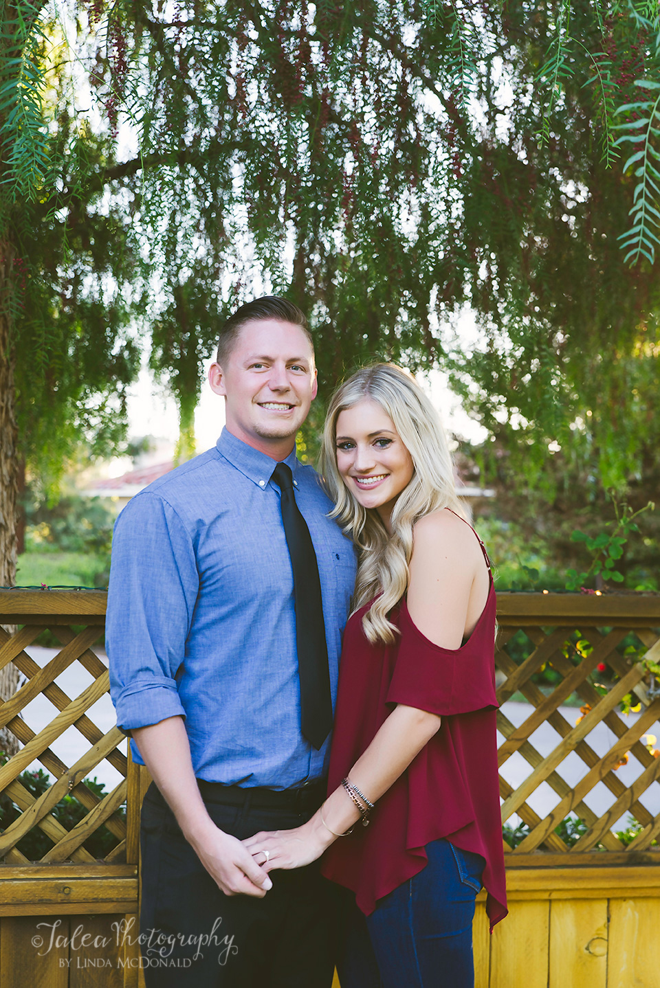 portrait of engaged couple posing at the south coast winery in Temecula