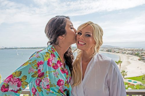 bridesmaid-kissing-bride-san-diego-wedding-photographer-catamaran-resort