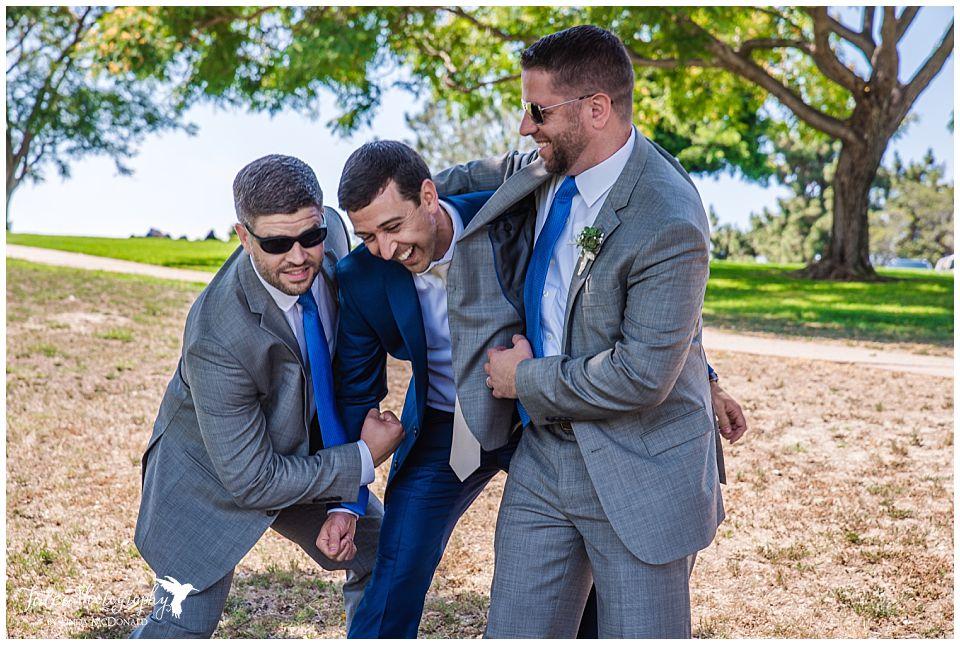 groomsmen-pretending-to-punch-groom
