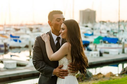 bride-groom-embracing-marina-village-weddings-san-diego