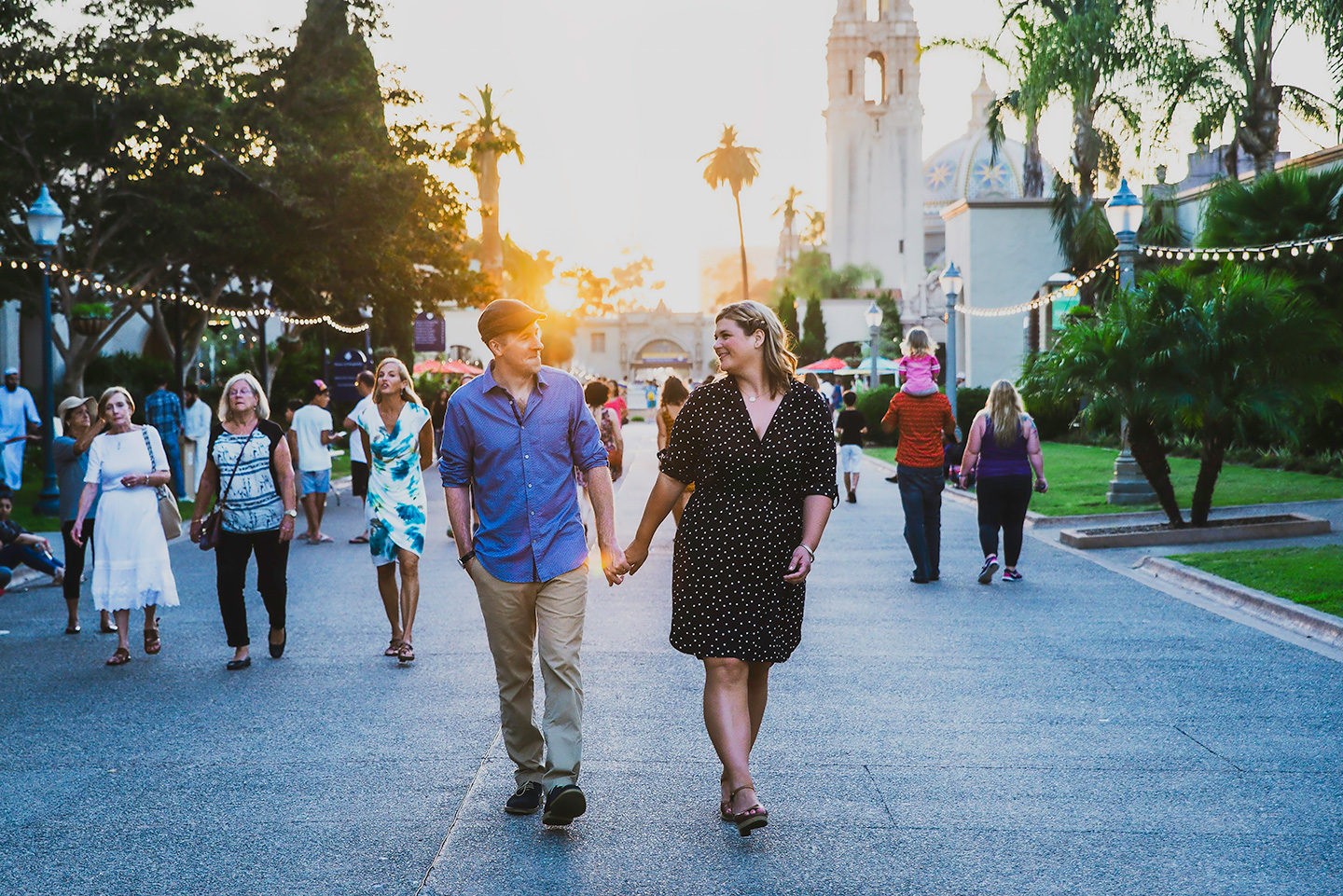 couple walking Balboa Park engagement photos