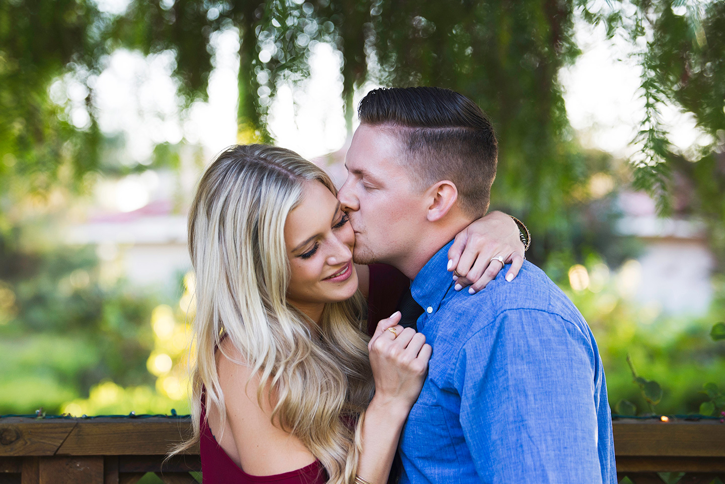engaged-couple-kissing-south-coast-winery-resort
