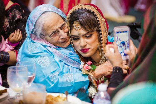 south-asian-bride-and-her-grandma-embracing-san-diego-photographer