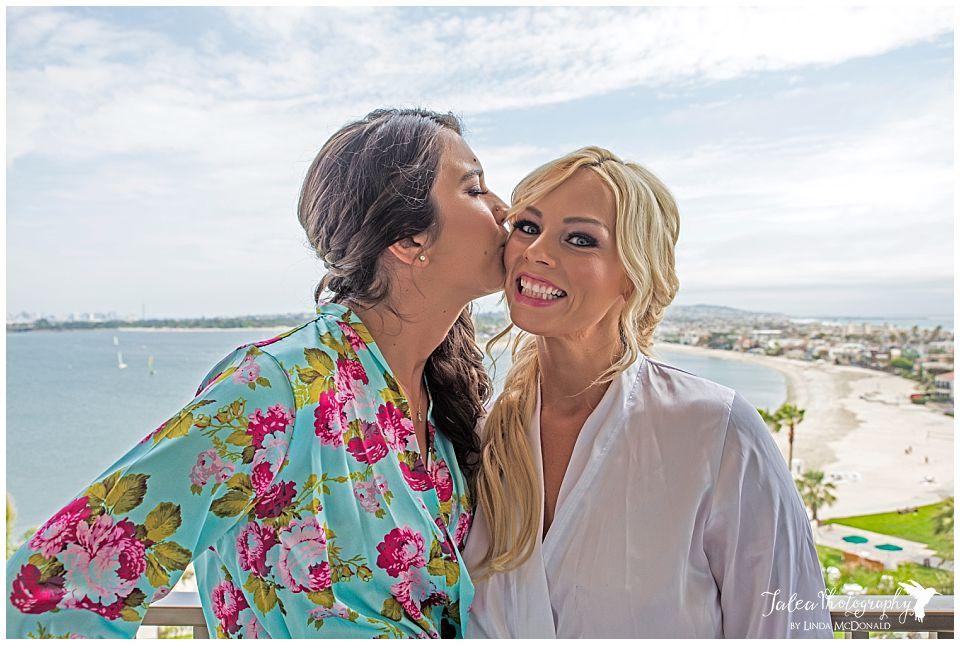 brides-maid-kissing-bride-on-the-cheek