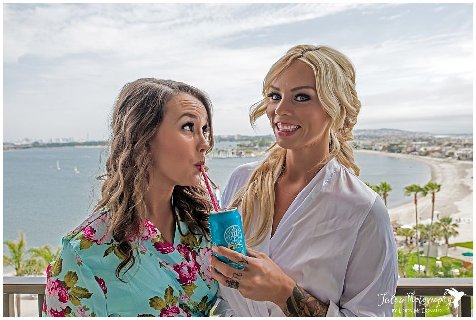 bridesmaid-sipping-out-of-that-bride-is-holding
