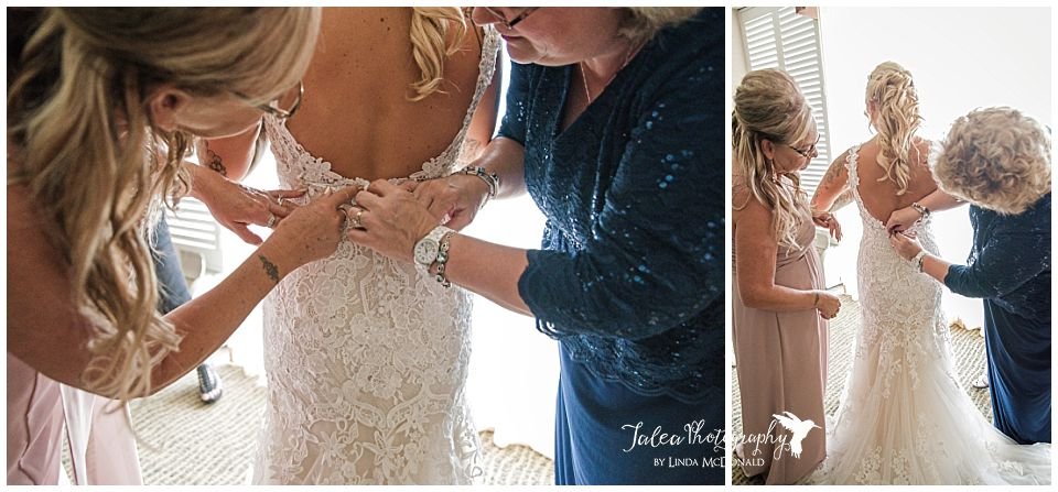 mom-mother-in-law-buttoning-up-bride's-dress