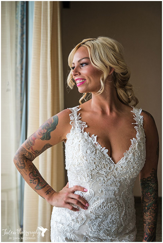 bride-in-wedding-dress-looking-out-the-window