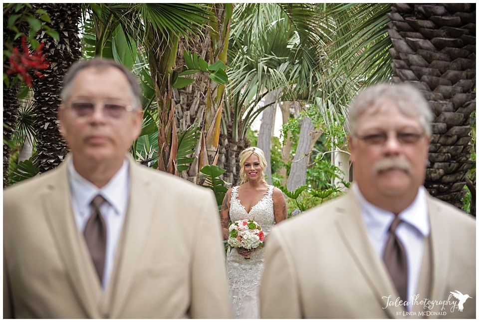 bride-approaching-two-dad's-for-first-look