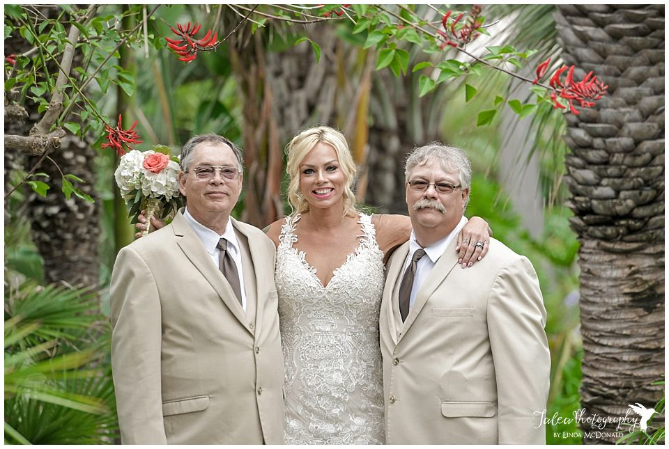 bride-posing-with-dad-and-step-father-after-first-look