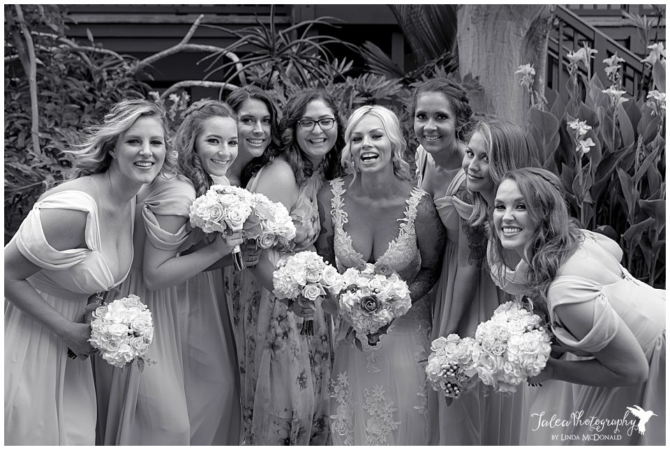 bride-bridesmaid-huddle-catamaran-resort-san-diego-garden