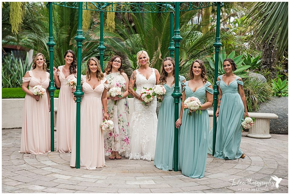 bridesmaid-standing-by-green-structure-catamaran-resort-san-diego-wedding