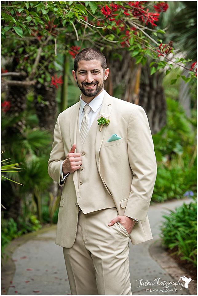 groom-posing-in-garden-at-catamaran-resort-san-diego