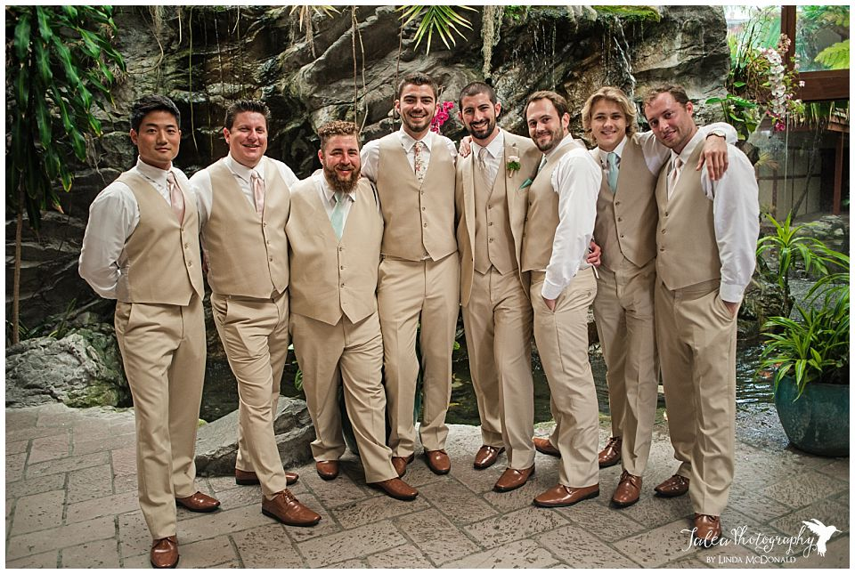catamaran-resort-san-diego-groom-groomsmen-standing-in-front-of-lobby-waterfall
