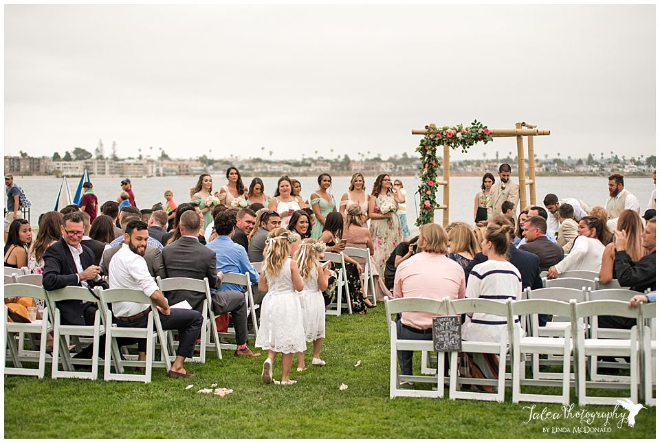 guest-watching-flower-girls-walk-down-the-aisle-mission-bay-wedding