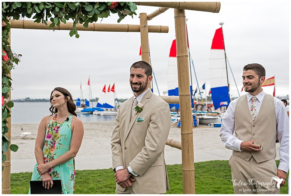 groom-waiting-for-bride-to-come-down-the-aisle-beach-front-wedding-san-diego