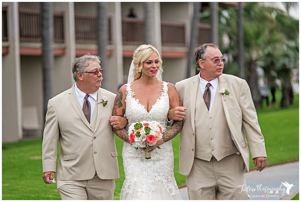 bride-walking-down-the-aisle-with-dad-and-step-father