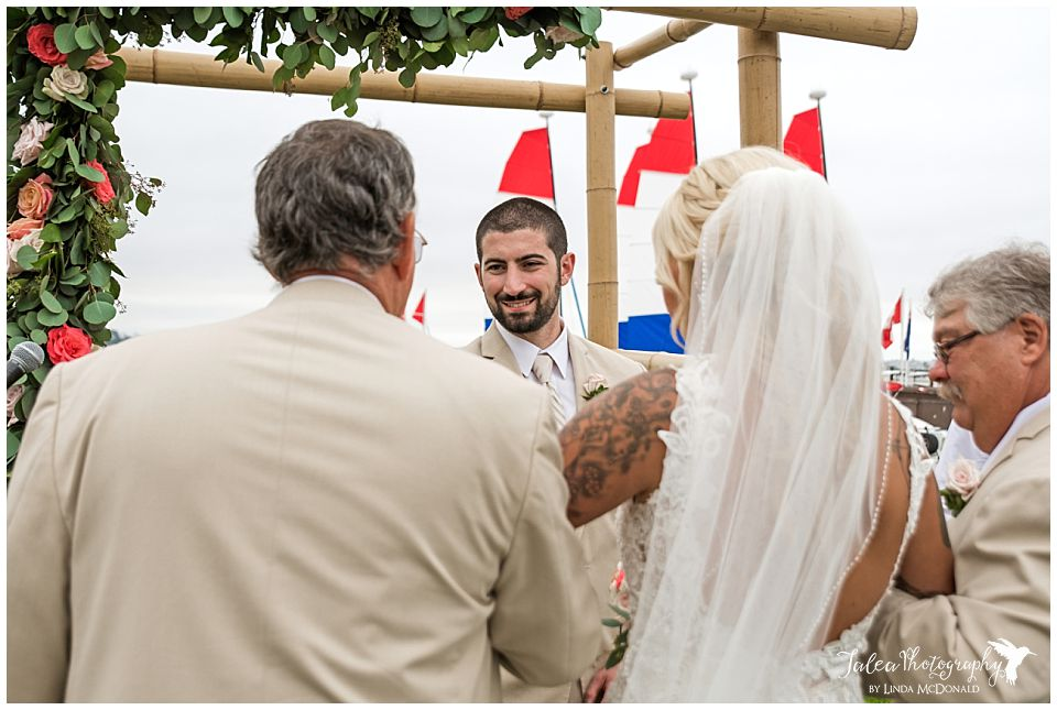 dad-giving-away-bride-to-groom-mission-bay-wedding