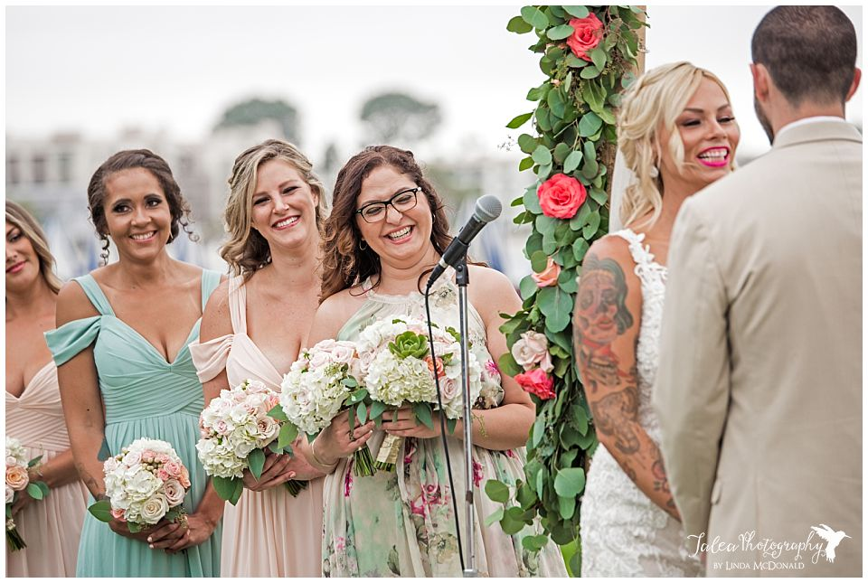 maid-of-honor-laughing-during-wedding-ceremony