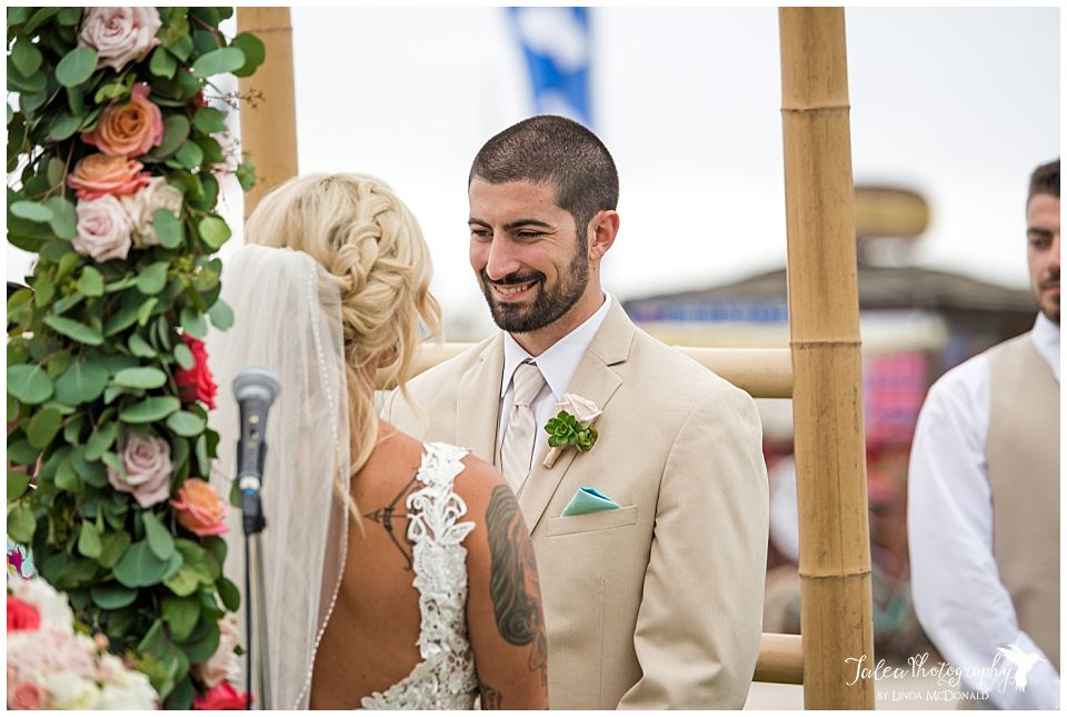 groom-looking-at-bride-during-ceremony