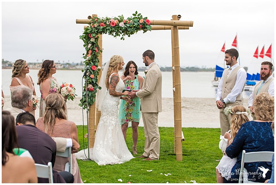 officiant-laughing-during-beach-front-ceremony