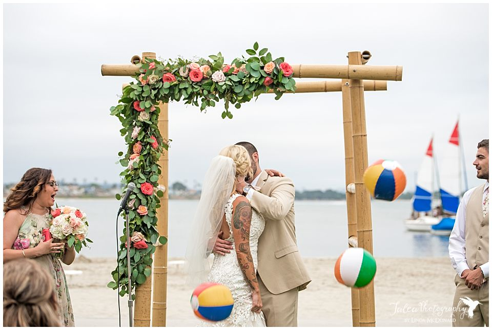 beachfront-wedding-ceremony-first-kiss