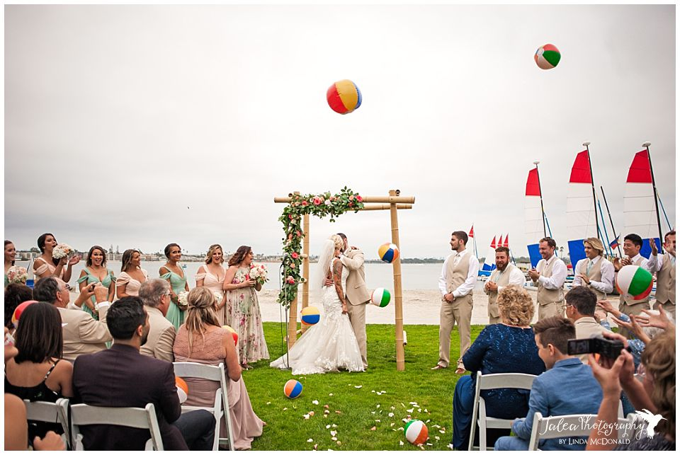 mission-bay-beach-front-wedding-ceremony-first-kiss-with-beach-balls