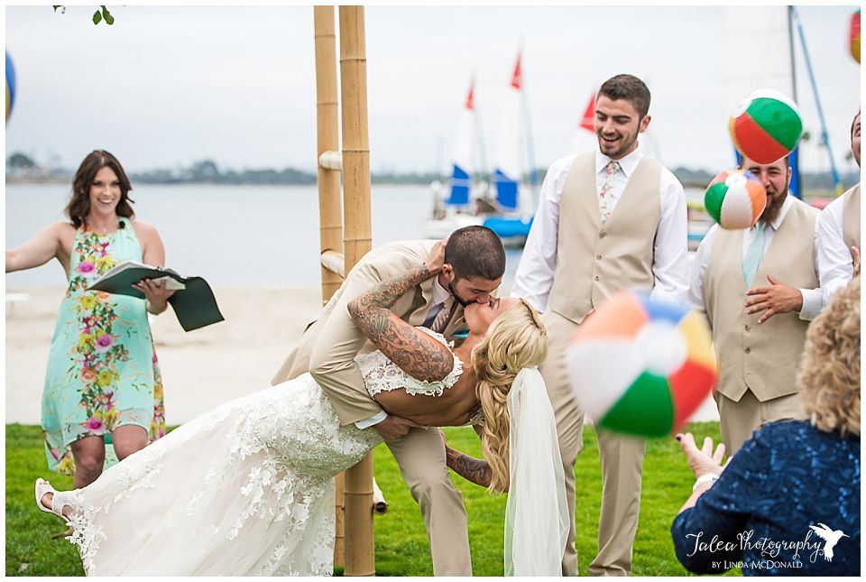 wedding-catamaran-san-diego-groom-dipping-bride-for-first-kiss
