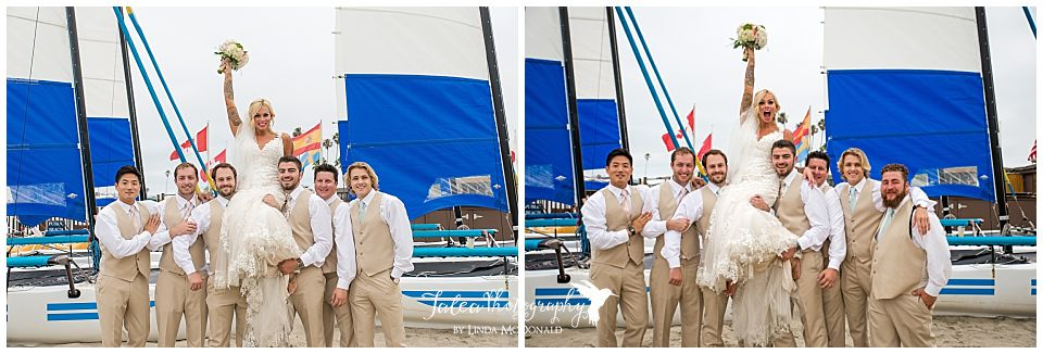 bride-propped-up-on-groomsmen-shoulder-san-diego-catamaran-resort